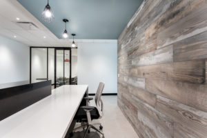 A gorgeous office designed with bright lighting and beautiful wood walls